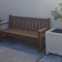 large custom planter boxes in a courtyard setting